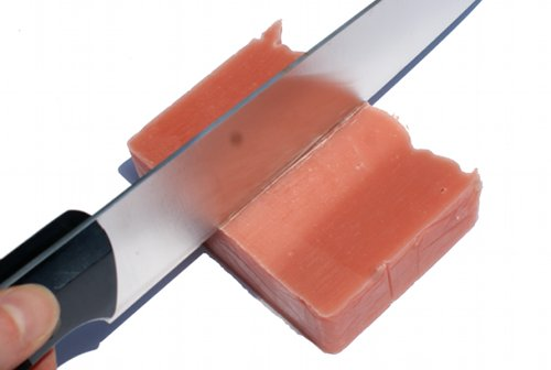 cutting handmade soap with a large knife