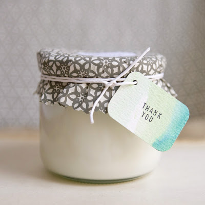 DIY Eco-Friendly Soy Wax Candles for Your Home! These hand poured candles also make great for Wedding Favors and Homemade Gifts! Learn how to make your own easy DIY eco-friendly soy wax candles with this simple candlemaking craft project from Ruffled blog!