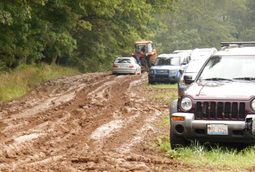 Cars being towed from Alpha Lot of the Mud Fest - er, Floyd Fest 12 Rise and Shine 2013