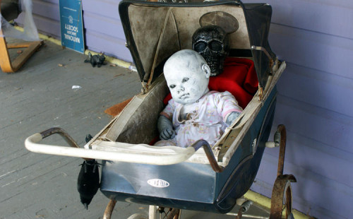 DIY Homemade Halloween Decorations - Dead Baby Doll Eerily Painted and Resting in a Baby Carriage