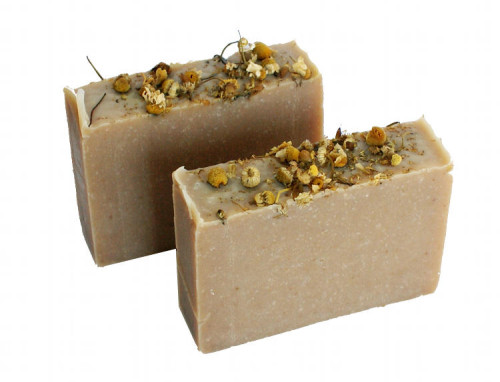 DIY Yogurt Soap with Chamomile! This all natural homemade yogurt soap recipe is handcrafted using the cold process soapmaking method. Made from a combination of real Greek yogurt, lavender & chamomile flower powders, and moisturizing blend of butters, this yogurt soap is the perfect treat for dry skin!