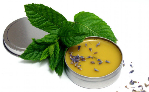 Lavender mint balm recipe! This plant based skin care salve is easy to make and is the perfect homemade gift idea for lavender lovers! Use this skin nourishing natural salve on your hands, body and even lips to promote healing and moisturize skin! #lavender #balm #salve #diy #crafts #plantbased #herbal #skincare #naturalskincare #homeremedy #mothersdaygift #crafts