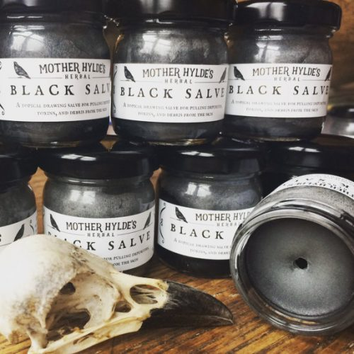 Mother Hylde's Black Drawing Salve combines the best drawing and skin healing herbs plus the power of activated charcoal and bentonite clay to pull impurities from the skin. Useful for pulling splinters, venom from bug bites, calming itch, pulling infection out of cuts, boils, acne, or any debris that may have invaded your skin.