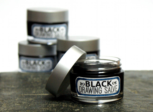 DIY black drawing salve. Black drawing salves are a wonderful home remedy for everything from bee stings and splinters to acne and boils. I first discovered black drawing salve when my son was around eight and developed a boil on this thigh. My grandmother recommended I buy a container of black salve from the pharmacist. I followed her instructions and it worked like a charm. Tracking down black salve locally these days can be a challenge however. So I created my own black drawing salve recipe with a bit of a twist and included green tea and honey in my recipe.