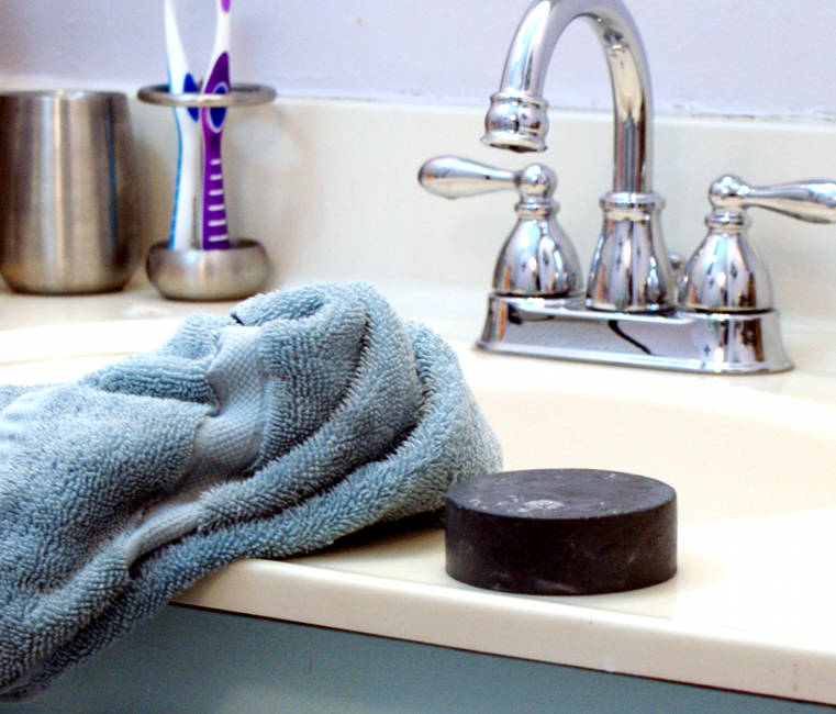 This easy natural Homemade Activated Charcoal Melt and Pour Soap Recipe that fights acne plus soothes and helps to heal skin.