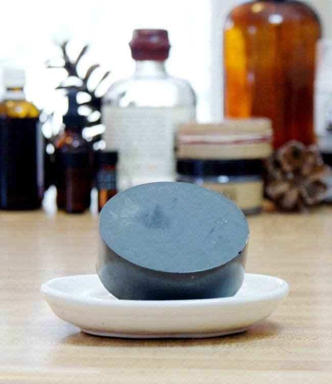 This easy to craft homemade activated charcoal melt and pour soap recipe fights acne plus soothes and helps to heal skin with natural essential oils.
