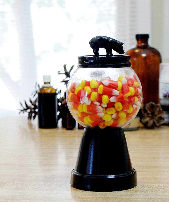 This DIY Halloween Candy Jar is quick and easy to make and looks great whether you're filling it with candy corn or gum balls! Learn how to make your own!