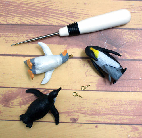 Learn how to make super cute DIY Penguin Christmas Ornaments for your tree or other home decor.