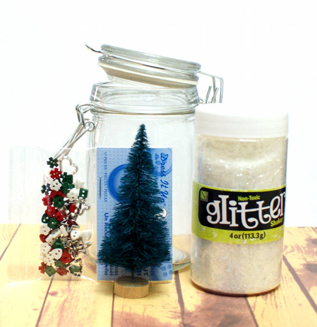 Craft this easy DIY waterless snow globe to use as part of your holiday home decor this Christmas.