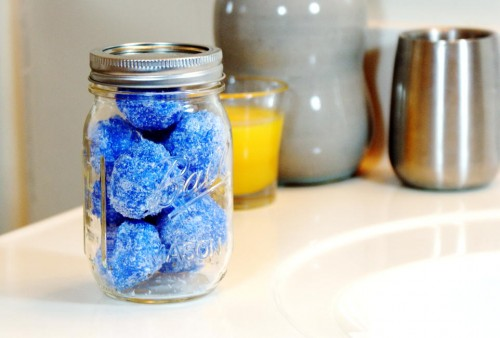 These sparkling DIY solid sugar scrub snowballs are not only a fun way to pamper yourself this winter, but they also make unique DIY Christmas gift ideas for any bath and body lover!