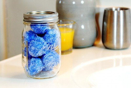 This solid sugar scrub recipe for making sparkling snowball shaped sugar scrubs is not only a fun way to pamper yourself this winter, but these snowball solid sugar scrubs also make unique DIY Christmas gift ideas for any bath and body lover!