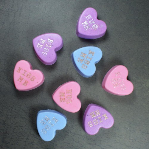 These DIY conversation heart soaps are so easy to make and make lovely homemade Valentine's Day gifts! Made from a melt and pour soap base, these conversation heart soaps can be made in an afternoon and ready to gift the same day. Simply package them in a plastic jar, wrap each soap individually or gift them inside candy treat bags.