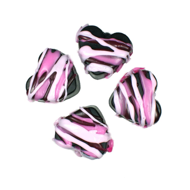 """Learn how to make these fun Joan Jett inspired Black Heart Valentine's Day Soaps featuring black heart soaps with pink """"icing!"""""""