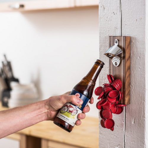 I love this DropCatch wall or magnetic mounted bottle opener with a magnetic cap catch! The DropCatch Pilsner Magnetic Bottle Opener uncaps all beer and soda bottles, utilizing a powerful permanent magnet to draw up to 70 bottle caps to its walnut surface. Plus it can be customized with a beautiful 3 to 12 letter engraving making it the perfect Father's day gift for Dads who love beer or craft sodas.