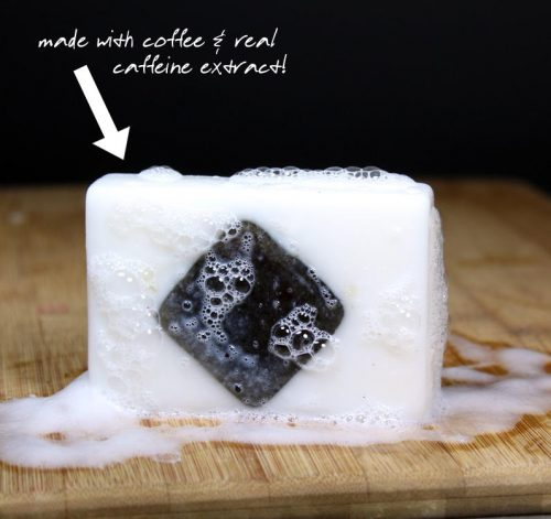 This easy caffeinated soap recipe has a fun coffee scrub center, giving you a fun two-in-one soap and scrub! Inspired by my orange and coconut scented coffee scrub recipe, this homemade caffeinated soap recipes combines gritty coffee scrub ingredients - pink Himalayan salt, brown sugar, and ground coffee - with real caffeine extract for that extra pick me up! Make them with your favorite detergent free soap base for homemade soaps that are not only fun to use, but are also fantastic to gift!