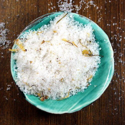 This relaxing chamomile calendula bath salts recipe is made using a simple combination of ingredients - natural salts, botanicals and coconut oil - that helps to relieve stress, condition and detoxify skin, and ease sore muscles and joint pain.