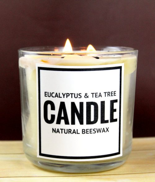 Want to make your own natural deodorizing beeswax candle? This natural deodorizing beeswax candle recipe is made with eucalyptus and tea tree essential oils and makes a great homemade holiday gift idea for friends and family! There are even free printable candle labels to make gifting even easier!