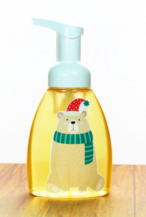 This holiday foaming hand soap DIY lends a festive touch to your foaming hand soap pumps! Learn how to create festive holiday images for your foaming hand soap containers as well as how to make your own peppermint scented foaming hand soap. All you need are three simple, natural ingredients. Not only will these festive holiday soap pumps look great in your bathroom, but they also make great homemade teacher gifts too!