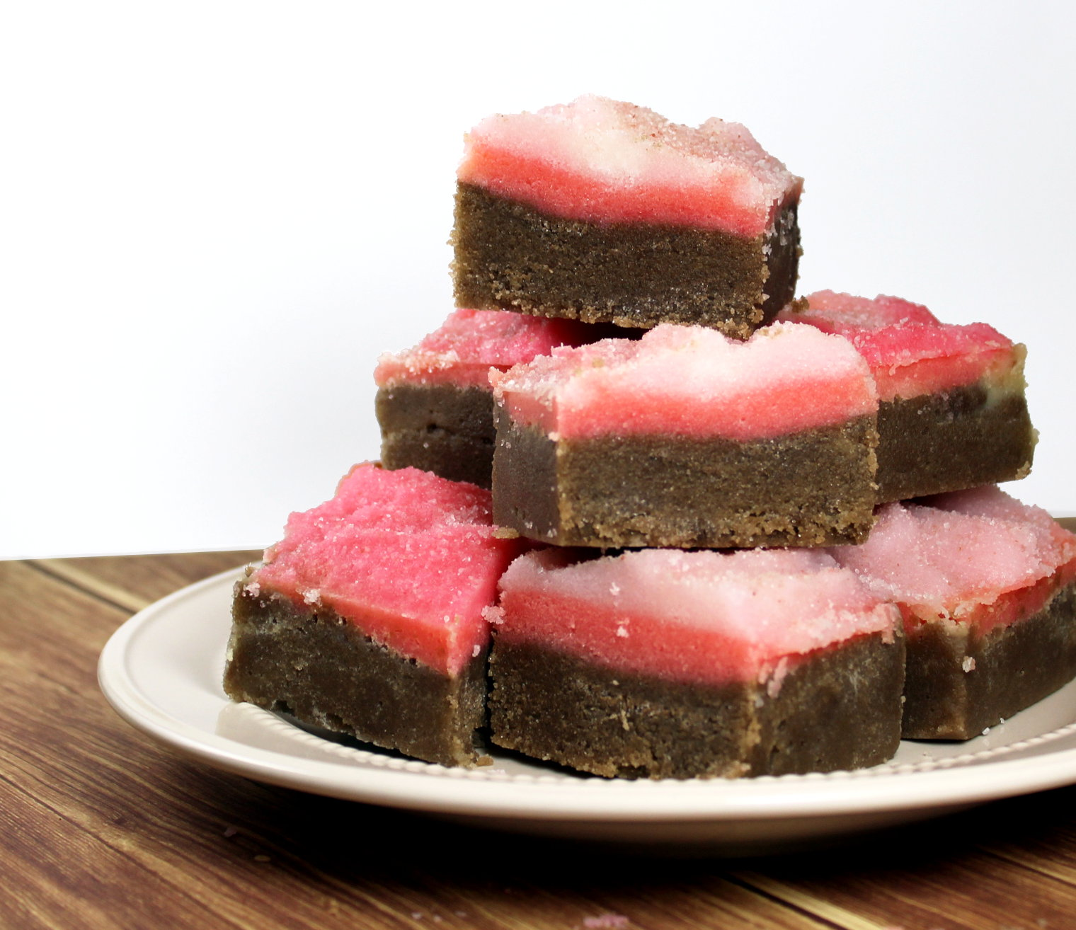 This strawberry and chocolate fudge solid sugar scrub bars recipe makes fantastic treats for your skin! Indulge in sugar and chocolate with none of the calories. These make great homemade gifts plus they're perfect for dry winter skin.