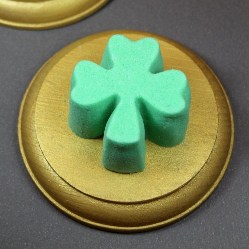 This easy fizzing shamrock bath truffles recipe creates a fizzy bath truffle that adds moisturizing cocoa butter to your bath water along with bubbles. While it doesn't have the dramatic effect of a bath bomb, it's perfect for those who prefer less flair in their bath water. You'll also find that my fizzing shamrock bath truffles recipe creates a product that's easy to remove from a silicone mold - so your fizzy bath truffles come out all in one piece!