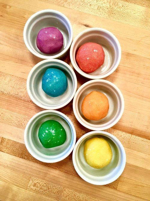 Rainbow Moldable Sugar Scrub Recipe! Learn how to make this fun sparkly, glittery rainbow colored moldable sugar scrub with my original semi-solid rainbow moldable sugar scrub recipe that you can mold and shape!
