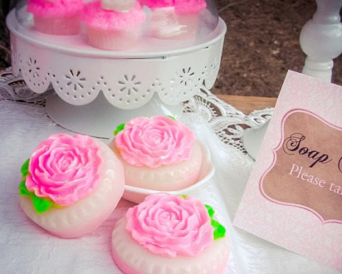 Rose cookie soap wedding favors from LolliLuscious. These handcrafted soaps are layered with delicate peony pink & shimmering pearl topped with a beautiful, blooming rose & delicate leaves.