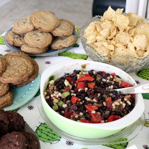 You must try this delicious Black Bean Dip Recipe for your next party! It's so simple to make. Just mix it all together the night before, refrigerate overnight and serve the next day!