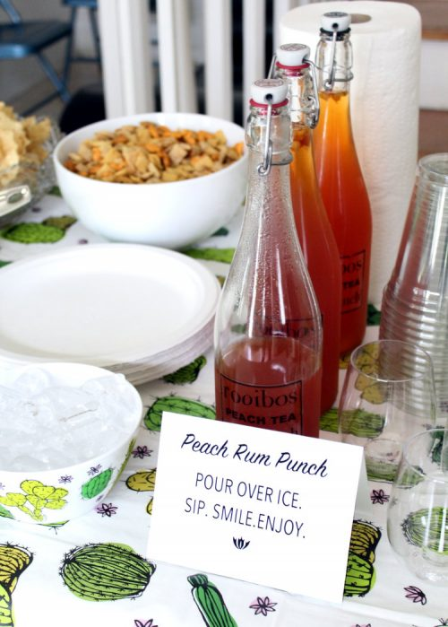 Rooibos Peach Tea Rum Punch Recipe! This spiked punch cocktail recipe is a real party pleaser and is made with a combination of light and dark rum as well as Adagio's Rooibos Peach Tea! It tastes exactly like peach tea!