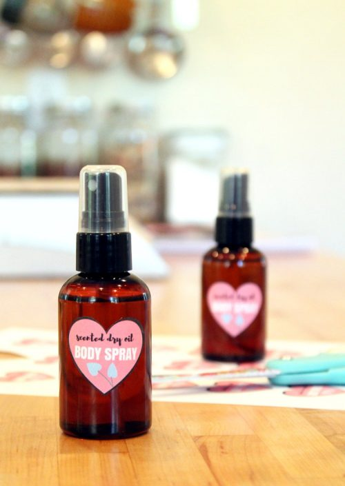 """This scented DIY dry oil body spray for dry skin is made with natural """"dry"""" oils that won't leave your skin feeling greasy but still nourish and moisturize skin in need. The addition of a fragrance means you can wear your favorite scent while still caring for your skin!"""