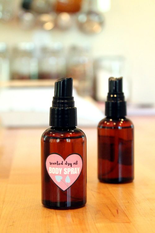 "This scented DIY dry oil body spray for dry skin is made with natural ""dry"" oils that won't leave your skin feeling greasy but still nourish and moisturize skin in need. The addition of a fragrance means you can wear your favorite scent while still caring for your skin!"