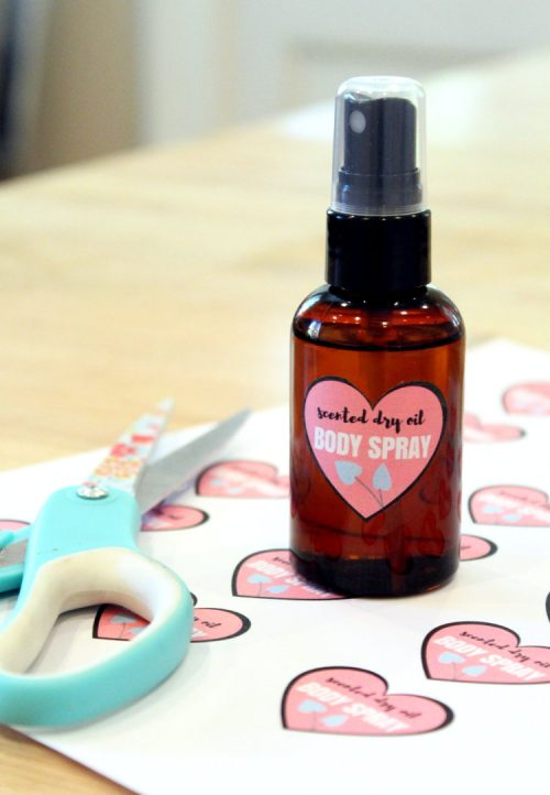 "DIY Last Minute Valentine's Day Gifts! This scented DIY dry oil body spray for dry skin is made with natural ""dry"" oils that won't leave skin feeling greasy but still nourish and moisturize skin in need. The addition of a fragrance means it can be worn in place of perfume while still caring for skin!"