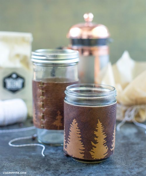 DIY Father's Day gift idea! Craft Dad this awesome DIY leather drink sleeve via Lia Griffith to help him keep a handle on his sweating beer mug during the hot summer months!