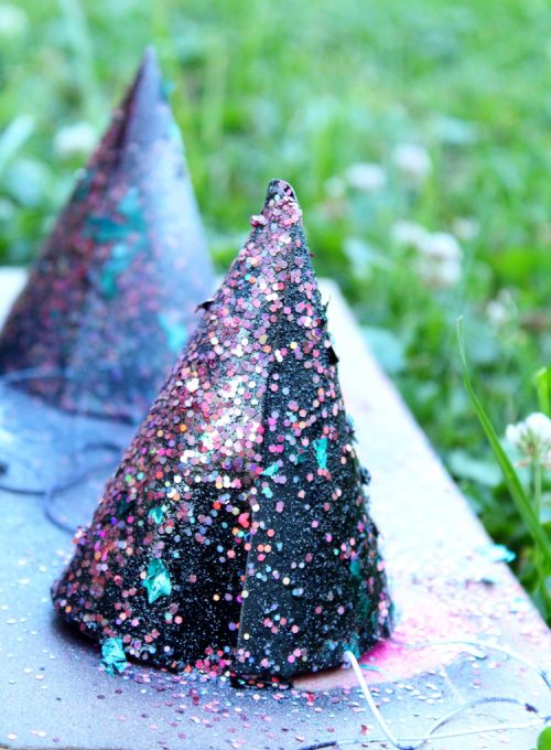 DIY Unicorn Party Hat Hack! These mini pineapple party hats were transformed to dreamy unicorn colors with spray paint and glitter!