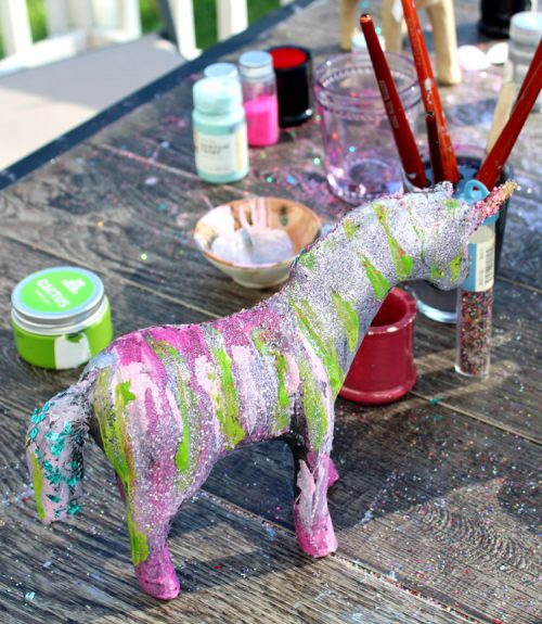 How to throw a unicorn party! Pair a paint your own unicorn paint project with fun DIY unicorn party hats and unicorn party favors for a magical event!
