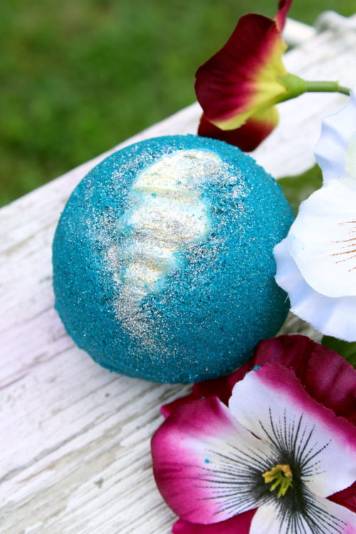 Mermaid Bath Bomb DIY! Learn how to DIY mermaid bath bombs for a fun and colorful addition to your bath time ritual. This mermaid lagoon bath bomb recipe yields two large bath bombs with moisturizing cocoa butter shells.
