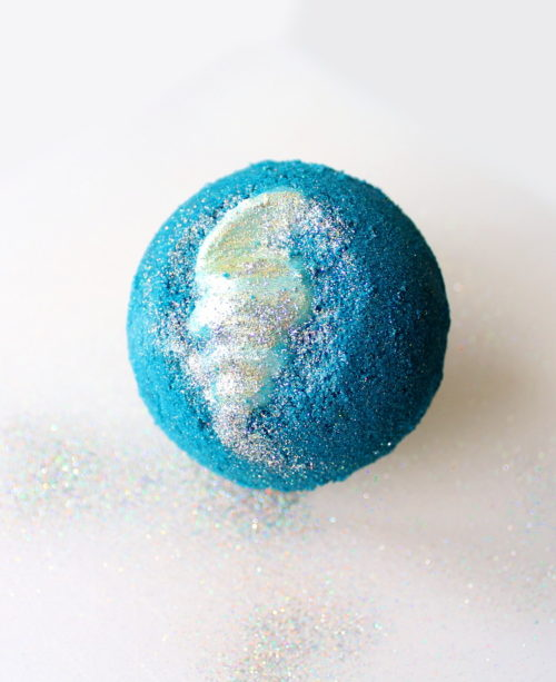 Mermaid Bath Bomb Recipe! Learn how to DIY mermaid bath bombs for a fun and colorful addition to your bath time ritual. This mermaid lagoon bath bomb recipe yields two large bath bombs with moisturizing cocoa butter shells.