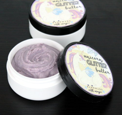 Unicorn Glitter Butter! This magical unicorn glitter butter recipe is perfect for parties and summer festivals! Scented with a sweet candy crush fragrance oil, this lavender colored unicorn glitter butter leaves a lovely layer of iridescent sparkly glitter on skin wherever it's applied!