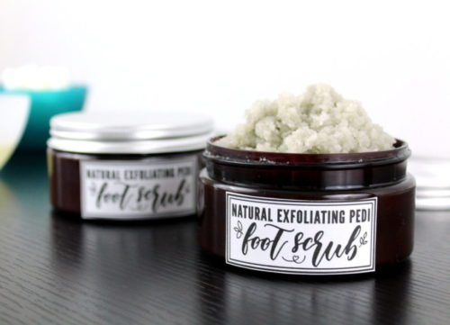 Pedi Foot Scrub Recipe with Coconut Oil! This super exfoliating pedi foot scrub recipe with coconut oil will leave your feet feeling like you just had a professional spa pedicure! Made with all natural ingredients, this pedi foot scrub exfoliates with fine sea salt and pumice. It then hydrates skin with shea butter and coconut oil for softer, smoother feet with every use!