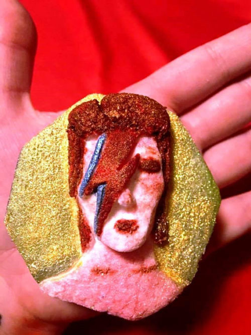 David Bowie Bath Bomb created by Glittery Nightmares on Etsy! This Starman inspired bath bomb is crafted using a handmade mold. It's then hand painted. Drop this homage to David Bowie in water and it will release an array of colors in red, yellow, pink, orange and blue. Plus a dash of glitter!