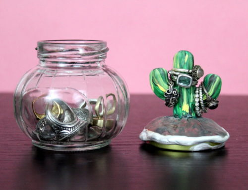 DIY Cactus Ring Holder! Learn how to make a DIY cactus ring holder! Made using polymer clay, this easy cactus ring holder offers a safe place to stash your rings! Molded onto the top of a decorative jar lid, this DIY cactus ring holders has space to stash your rings both inside the jar and out!