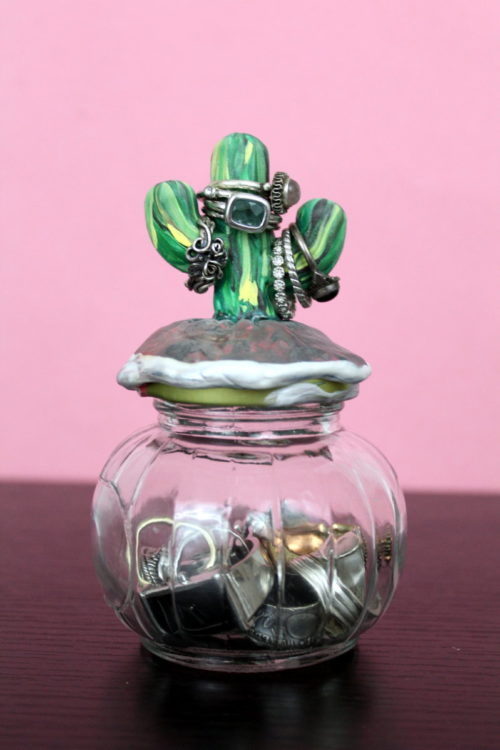 DIY Cactus Ring Holder! Learn how to make a DIY cactus ring holder! Made using polymer clay, this easy cactus ring holder offers a safe place to stash your rings! Molded onto the top of a decorative jar lid, this DIY cactus ring holder has space to stash your rings both inside the jar and out! And it makes a great DIY gift idea too!