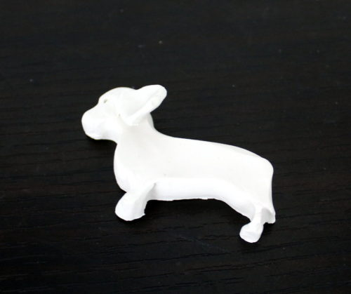DIY Dachshund Magnet! Learn how to create a super cute DIY dachshund magnet for your fridge! This super cute magnet is great for displaying your children's drawings or photos on the refrigerator. Or, use this little guy to keep coupons or recipes handy and within easy reach!