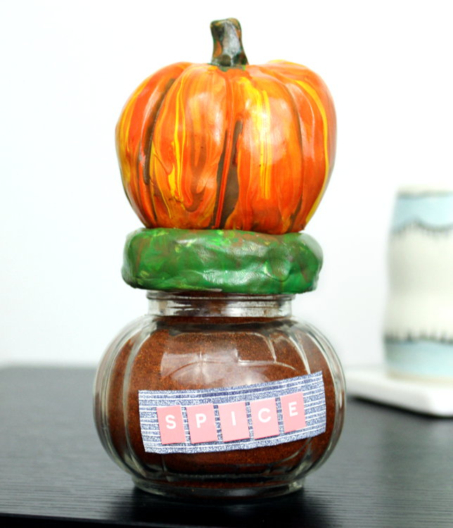 DIY Pumpkin Jars! Learn how to make your own DIY pumpkin jars for fall from polymer clay and paints! These fun jars are great for stashing candy or other treats inside while also adding to your fall inspired home decor. Alternately, these DIY pumpkin jars are also great for gifting! Simply fill them with homemade pumpkin spice mix, attach a tag and gift them to neighbors and teachers!