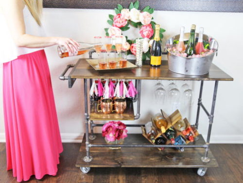 Industrial Bar Cart! I love this this brilliantly designed industrial bar cart from Fry By Design that offers three storage levels and a hanging wine glass rack.