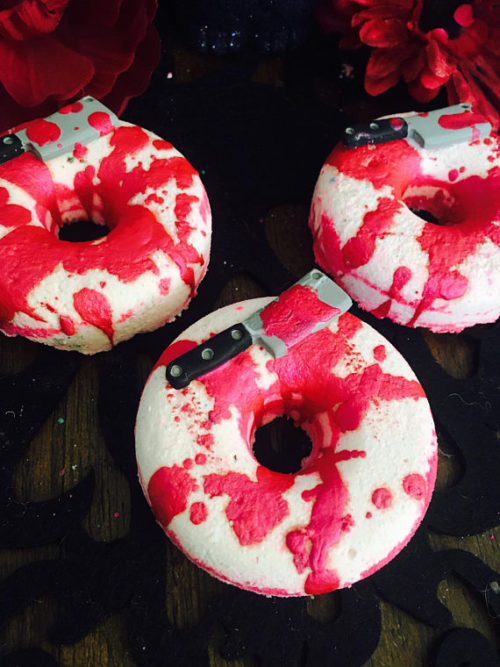 Lizzie Borden Inspired Hatchet Bath Bomb from Sea Mist Co. Lizzie Borden took an ... well, a hatchet? A hatchet works just as well as an ax for round two of this slaughter from Sea Mist Co. that comes in the form of red & white bourbon barrel scented bath bomb.