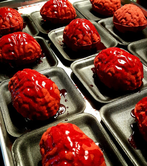 Meat Platter Brain Bath Bomb from The Mad Bombers! Brains are all the rage among cannibals and zombies alike. Get yours bath bomb style and served up on a platter from The Mad Bombers. Scented in winter apple, these bloody brains will look like a suicide in your bathtub by the time their done. After all a good hostess does prepare for every kind of guest.