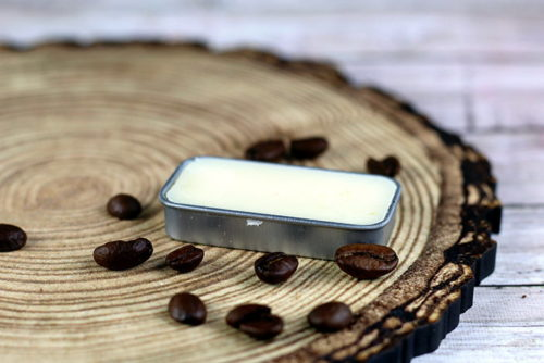 Coffee Lip Balm Recipe! If you love coffee then you must try this easy 3-ingredient coffee lip balm recipe! Made using a coffee infused oil for flavor and scent, this easy DIY lip balm saves you money while also offering a quality product. #coffee #lipbalm #diy #crafts #skincare #beauty #lipbalmrecipe #natural #naturalskincare #lipbalmrecipe