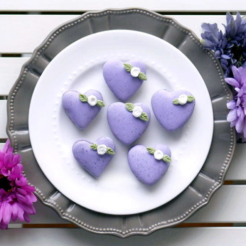 These heart shaped DIY Earl Grey Macarons with Mouth-watering Lemon Swiss Buttercream via Indulge with Mimi are the perfect alternative to the traditional Valentine's Day box of chocolates! Get the recipe and heart shaped template now at Indulge with Mimi.