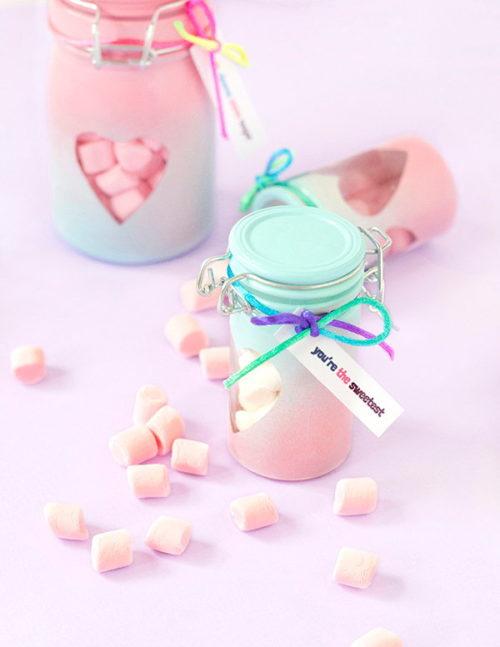 These DIY Valentine's Day Treat Jars via Make + Tell are perfect for gifting Valentine's Day treats and candy! #valentines #valentinesdaygift #treats #favors #ombre #candy #treats #diy #crafts