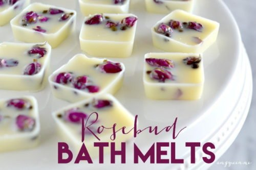 These DIY Rosebud Bath Melts via Amy Green are crafted with natural skin nourishing ingredients like cocoa and shea butters and coconut oil. The addition of dried mini-rose buds give them an extra feeling of love and romance make them perfect to give as DIY Valentine's Day gifts. #valentinesdaygift #diy #bathmelts #roses #skincare